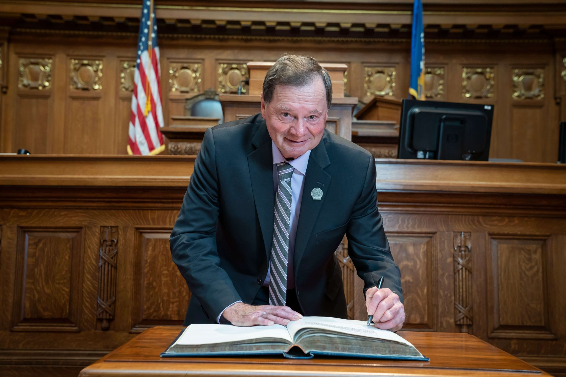 Rep Vruwink signs the book